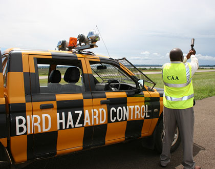 A-Staff-of-Bird-Hazard-Control-demonstrating-with-a-Signal-Pistol-on-how-to-scare-away-birds-from-the-runway-at-Entebbe-International-Airport
