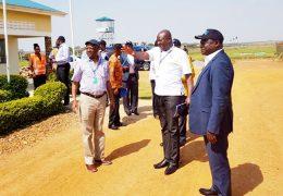 Board-members-at-Arua Airfield