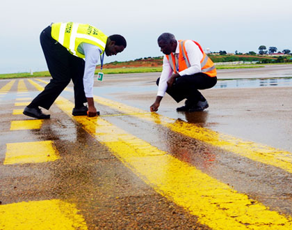 CAA-Staff-carrying-out-runway-inspection-at-Entebbe-International-Airport