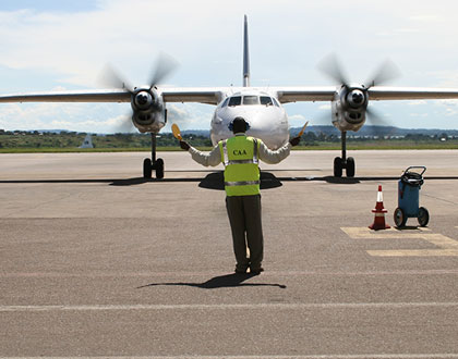 CAA-Uganda-staff-marshalling-aircraft-at-Entebbe-International-Airport