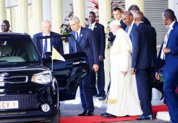 Pope-Francis-being-escorted-to-his-vehicle-by-Vice-President-Dr.-Ruhakanaa-Rugunda