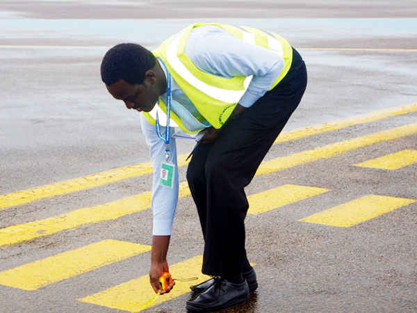 Staff-carrying-out-runway-inspection-at-Entebbe-International-Airport